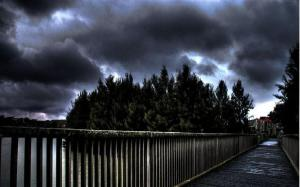 pedestrian_bridge_under_stormy_skies_hdr