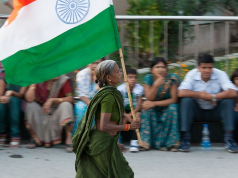 punjab-india-wagah-border-ceremony-h-elderly-indian-women-running-with-an-indian-flag.jpg